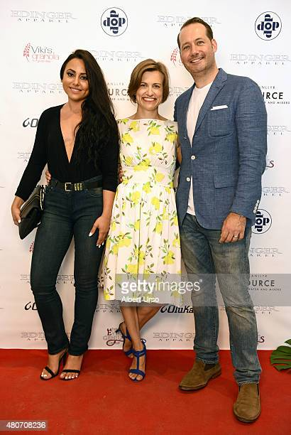 Designers Erik Nelson and Emily Cummings poses with actress Olivia Blois Sharpe on the red carpet at the Edinger Apparel presentation during New York...