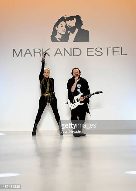 Designers Estel Day and Mark Tango pose on the runway at Mark And Estel fashion show during Mercedes-Benz Fashion Week Fall 2014 at The Salon at...