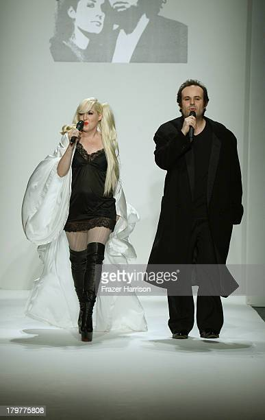 Designers Estel Day and Mark Tango walk the runway at the Mark And Estel fashion show during Mercedes-Benz Fashion Week Spring 2014 at The Studio at...