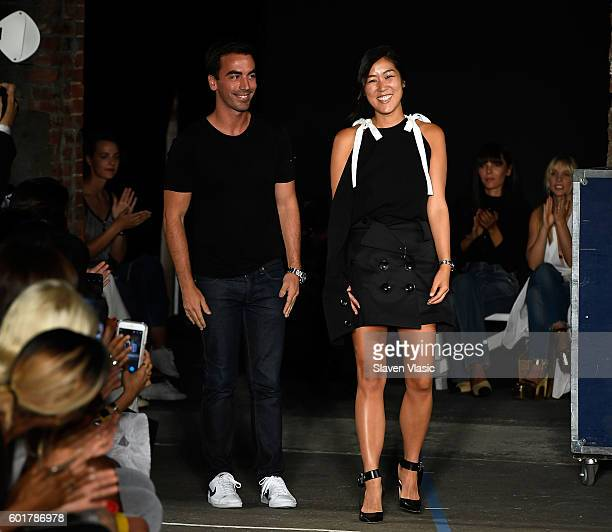 Designers Fernando Garcia and Laura Kim walk the runway at the Monse fashion show during New York Fashion Week September 2016 at Art Beam on...