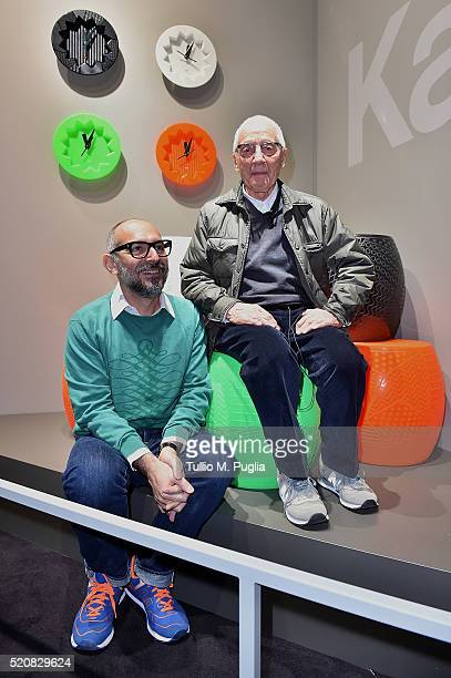 designers Ferruccio Laviani and Alessandro Mendini pose at Kartell Talking Minds during Milan Design Week 2016 on April 13 2016 in Milan Italy