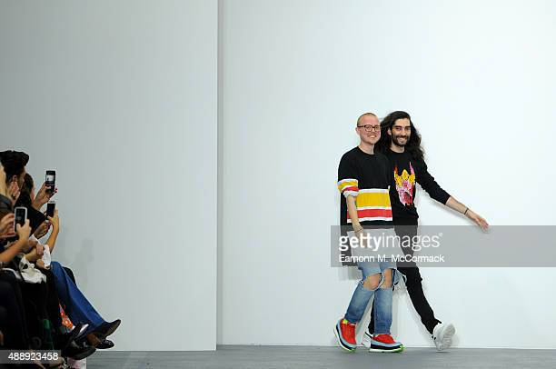 Designers Fyodor Podgorny and Golan Frydman appear at the end of the runway following the Fyodor Golan show during London Fashion Week Spring/Summer...
