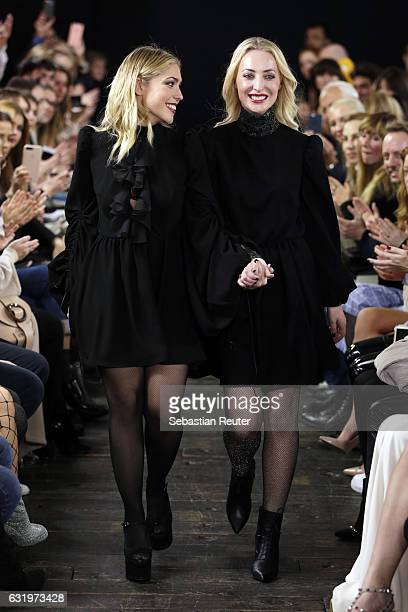 Designers Gelena Roizen and Lana Mueller acknowledge the audience following her show during the MercedesBenz Fashion Week Berlin A/W 2017 at Soho...