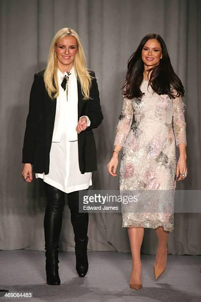 Designers Georgina Chapman and Keren Craig walk the runway at Marchesa during MercedesBenz Fashion Week Fall 2014 at New York Public Library on...