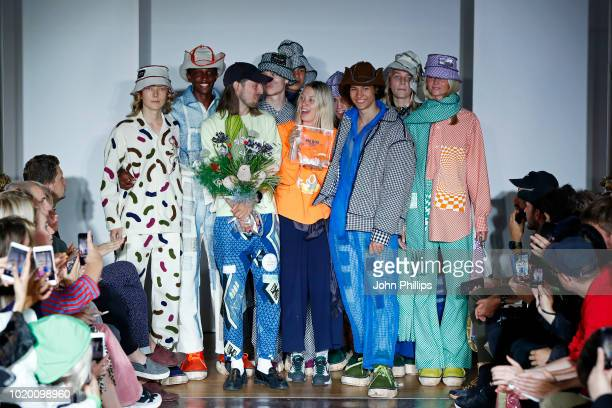 Designers Ida Falck Oien and Harald Lunde Helgesen celebrate with models after they won the Bik Bok Runway Award during Oslo Runway SS19 at...
