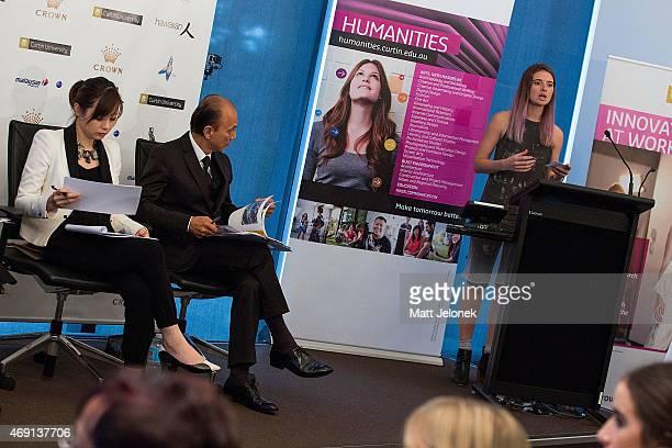 Designers Illiza Ho and Jimmy Choo listen to a student at Fashion Tank - Perth on April 10, 2015 in Perth, Australia. Designer Professor Datuk Jimmy...