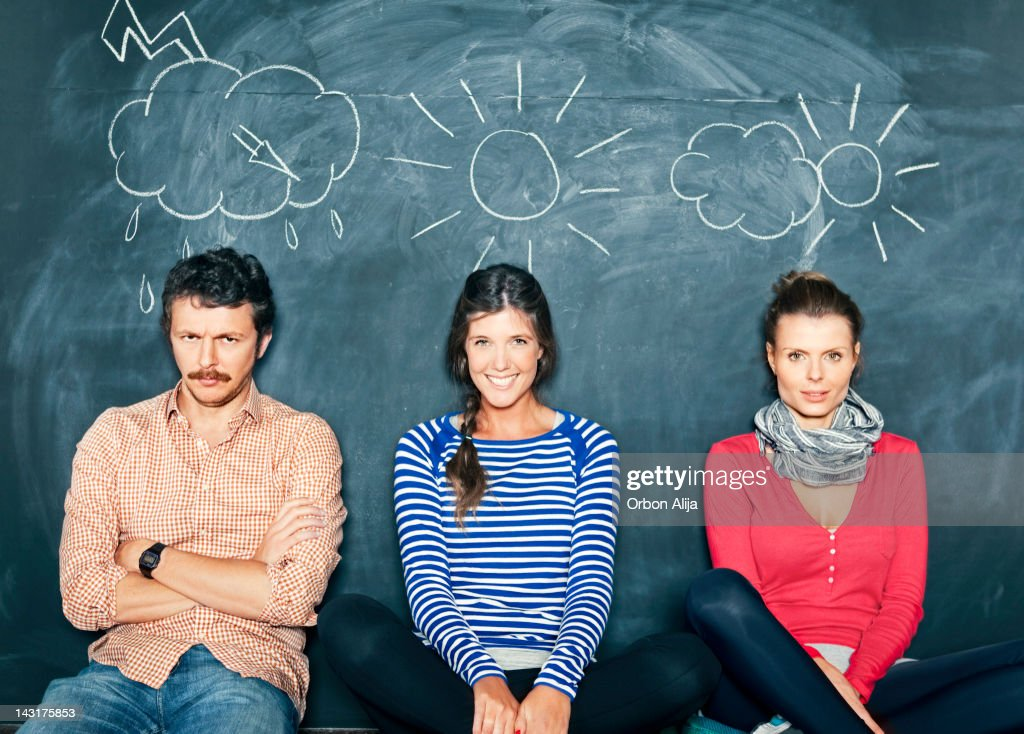 Designers in front of a blackboard : Stock Photo