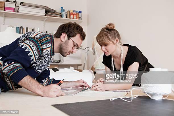 designers in workshop - デザイナー服 ストックフォトと画像