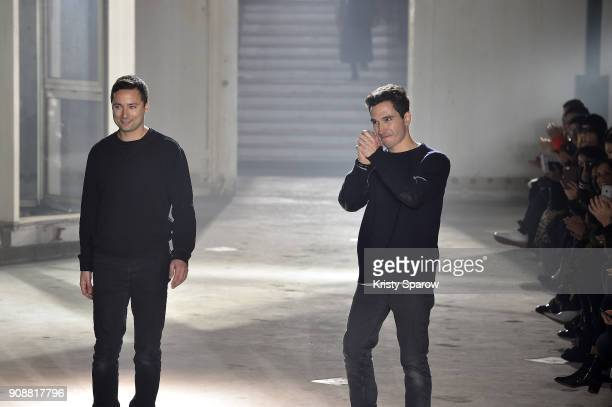 Designers Jack McCollough and Lazaro Hernandez acknowledge the audience during the Proenza Schouler RTW Fall/Winter 2018 show as part of Paris...