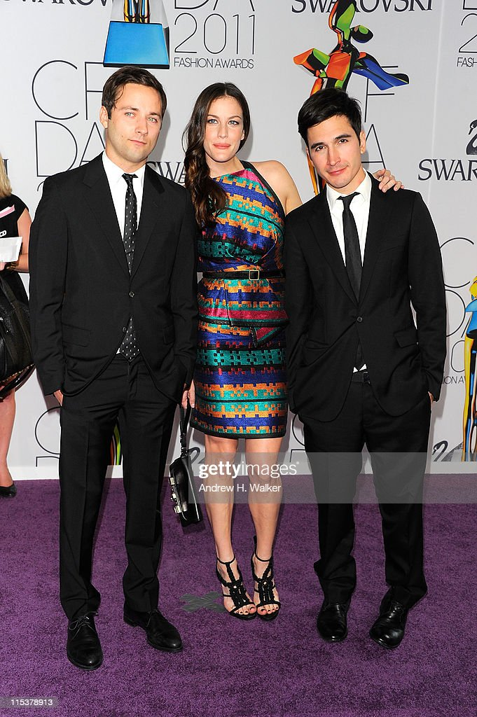 Designers Jack McCollough (L) and Lazaro Hernandez (R) of Proenza Schouler and actress Liv Tyler (C) attend the 2011 CFDA Fashion Awards at Alice Tully Hall, Lincoln Center on June 6, 2011 in New York City.