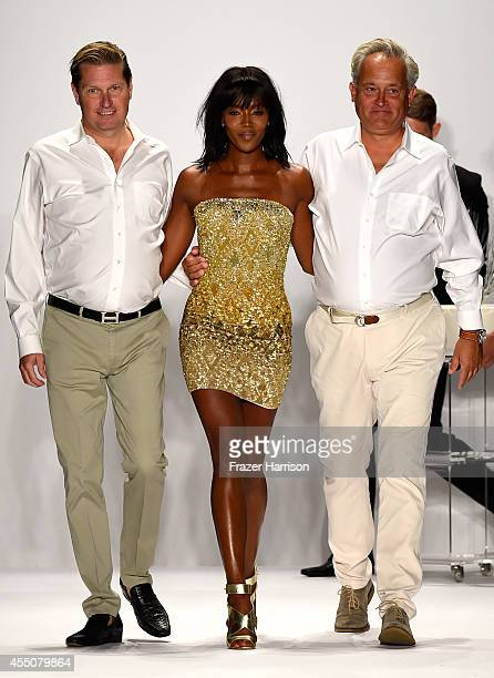 Designers James Mischka and Mark Badgley walk the runway with model Naomi Campbell walk the runway at the Badgley Mischka fashion show during...