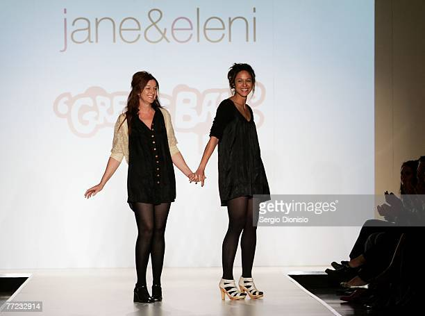 Designers Jane Arifien and Eleni Arifien of the label jane&eleni greet the audience following their catwalk collection show as part of the New...