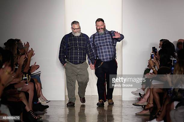 Designers Jeffrey Costello and Robert Tagliapietra greet the audience after their runway Show at Costello Tagliapietra during MADE Fashion Week...