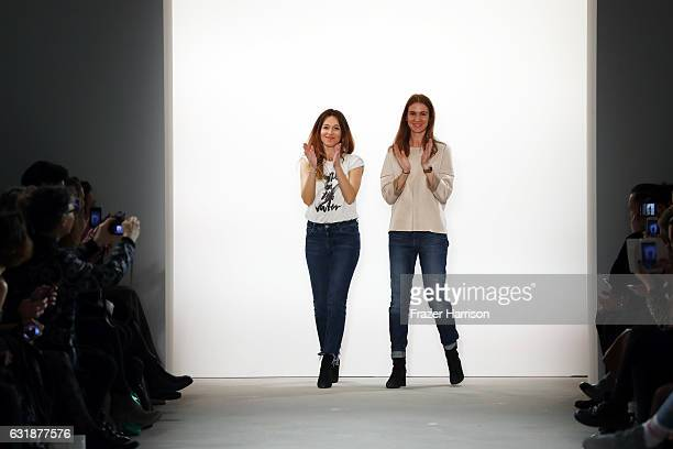 Designers Jelena Hofmann and Sedina Halilovic acknowledge the audience after their holyGhost show during the MercedesBenz Fashion Week Berlin A/W...