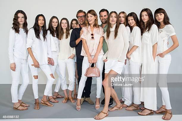 Designers Jens Grede and Erik Torstensson pose with model / blogger Hanneli Mustaparta at the Frame Denim presentation on September 3 2014 in New...