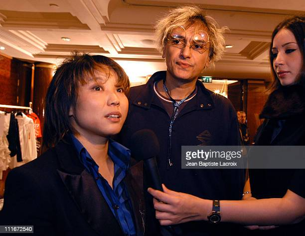 Designers Ji and Felix being interviewed during Paris Fashion Week Haute Couture Spring/Summer 2004 - Ji Haye - Backstage and Front Row at George V...