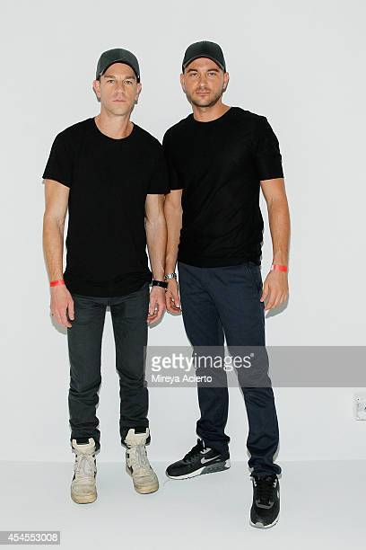 Designers Josh Reed and Trey Alligood of Gents pose at the Gents presentation during New York Men's Day at Industria Studios on September 3 2014 in...