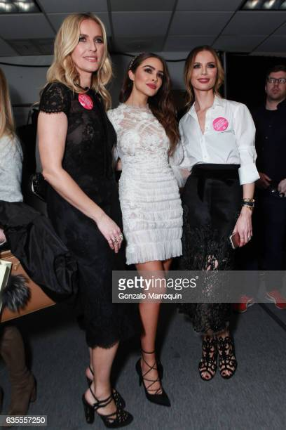Designers Karen Craig and Georgina Chapman pose with Olivia Culpo backstage after the Marchesa Fashion Show during New York Fashion Week at Skylight...