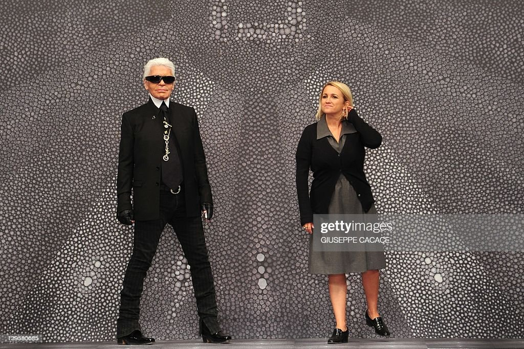 591ff267e46f Designers Karl Lagerfeld and Silvia Fendi acknowledge the audience ...