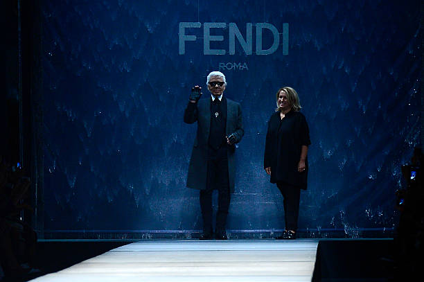 1b99e41cccee Designers Karl Lagerfeld (L) and Silvia Fendi acknowledge the audience at  the end of