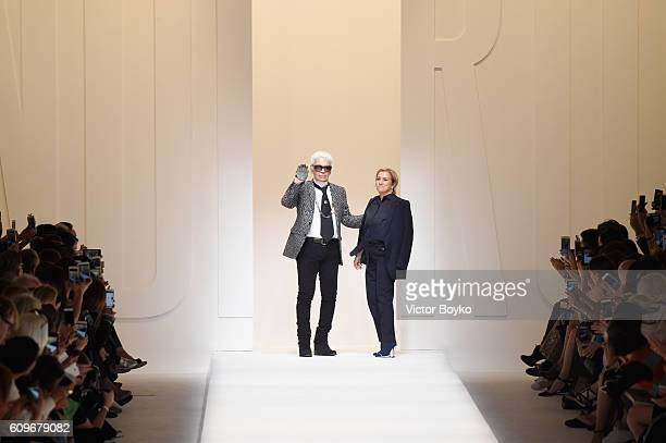 Designers Karl Lagerfeld and Silvia Venturini Fendi acknowledge the applause of the audience at the Fendi show during Milan Fashion Week...