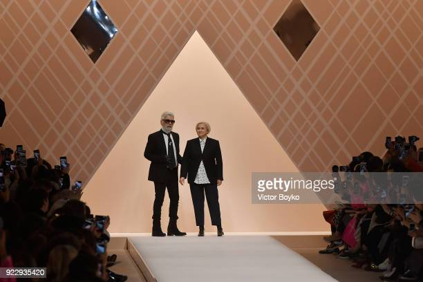 Designers Karl Lagerfeld and Silvia Venturini Fendi acknowledge the applause of the audience runway at the Fendi show during Milan Fashion Week...
