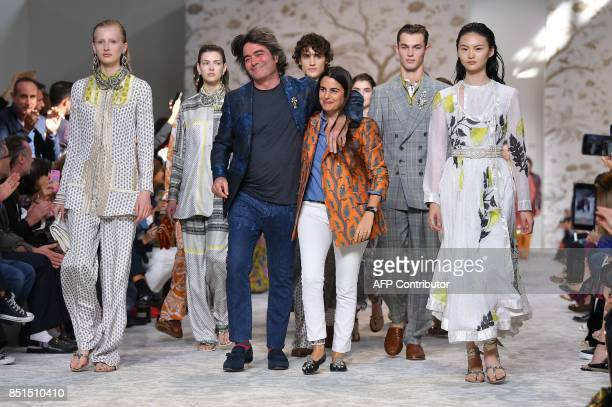 Designers Kean Etro and his sister Veronica Etro greet the audience at the end of their show Etro during the Women's Spring/Summer 2018 fashion shows...