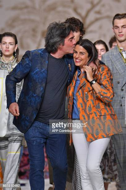 Designers Kean Etro gives a kiss to his sister designer Veronica Etro greet the audience at the end of their show Etro during the Women's...