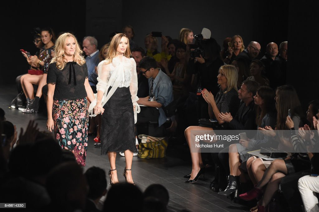 Designers Keren Craig and Georgina Chapman walk the runway after the Marchesa fashion show during New York Fashion Week: The Shows at Gallery 1, Skylight Clarkson Sq on September 13, 2017 in New York City.