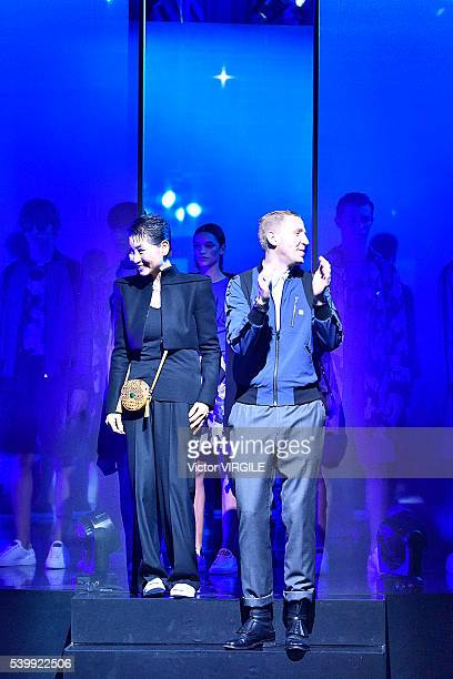 Designers Kim Sungjoo and Christopher Raeburn walk the runway at the MCM X Christopher Raeburn show during The London Collections Men SS17 on June 11...