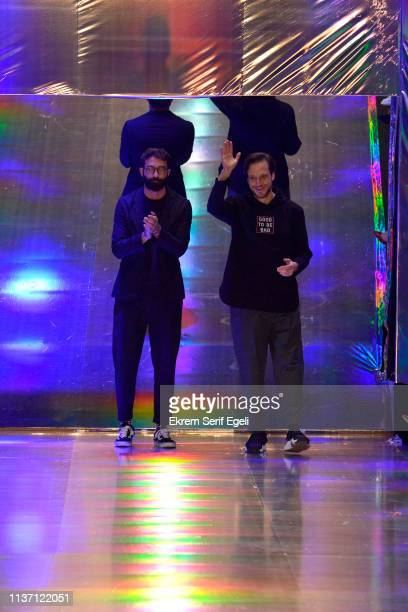 Designers Koray Arici and Volkan Guzelce acknowledge the applause of the audience after the Brand Who show during MercedesBenz Istanbul Fashion Week...
