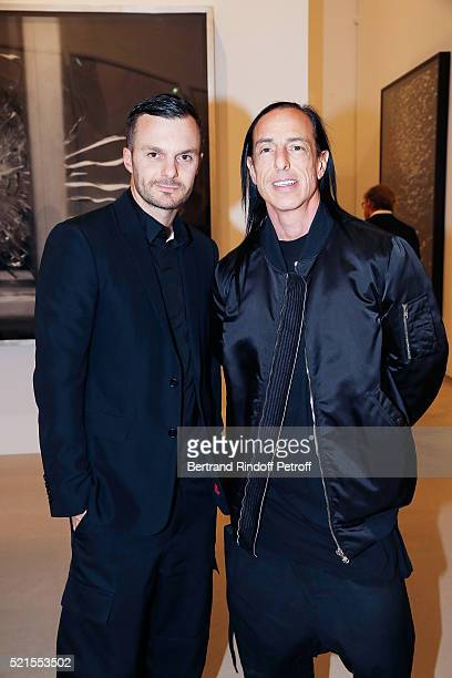 Designers Kris van Assche and Rick Owens attend the Robert Longo Exhibition at Galerie Thaddeus Ropac on April 15 2016 in Paris France