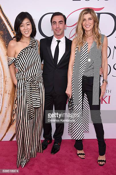 Designers Laura Kim and Fernando Garcia pose with guest attend the 2016 CFDA Fashion Awards at the Hammerstein Ballroom on June 6 2016 in New York...
