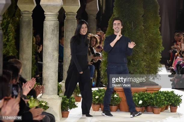 Designers Laura Kim and Fernando Garcia walk the runway at Oscar De La Renta during New York Fashion Week at the Cunard Building on February 12, 2019...