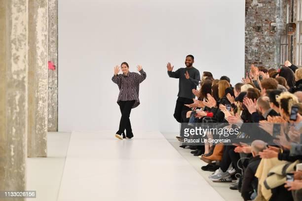 Designers Lisi Herrebrugh and Rushemy Botter walk the runway during the Nina Ricci show as part of the Paris Fashion Week Womenswear Fall/Winter...