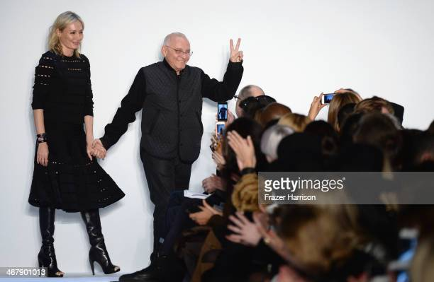 Designers Lubov and Max Azria walk the runway at the Herve Leger By Max Azria fashion show during MercedesBenz Fashion Week Fall 2014 at The Theatre...