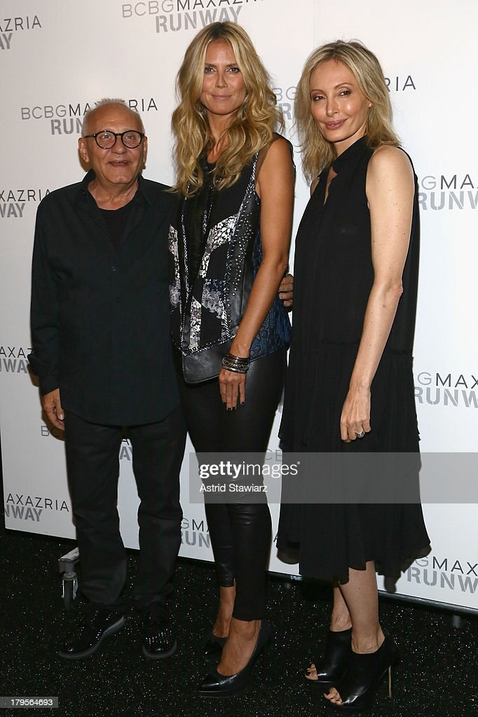 Designers Lubov Azria (R) and Max Azaria pose with model Heidi Klum backstage at the BCBGMAXAZRIA Spring 2014 fashion show during Mercedes-Benz Fashion Week at The Theatre at Lincoln Center on September 5, 2013 in New York City.