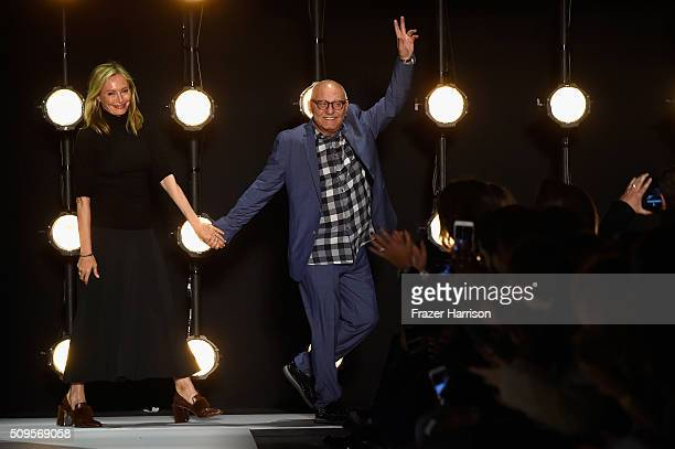 Designers Lubov Azria and Max Azria greet the audience from the runway wearing BCBGMAXAZRIA Fall 2016 during New York Fashion Week The Shows at The...