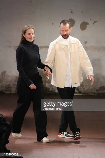 Designers Lucie Meier and Luke Meier walk the runway at the Jil Sander show at Milan Fashion Week Autumn/Winter 2019/20 on February 20 2019 in Milan...