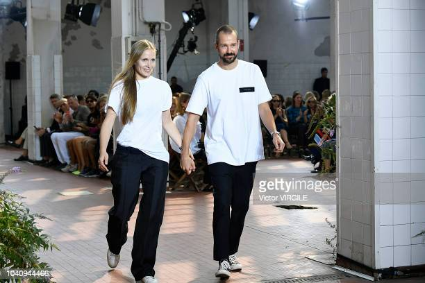 Designers Lucie Meier and Luke Meier walk the runway at the Jil Sander Ready to Wear fashion show during Milan Fashion Week Spring/Summer 2019 on...