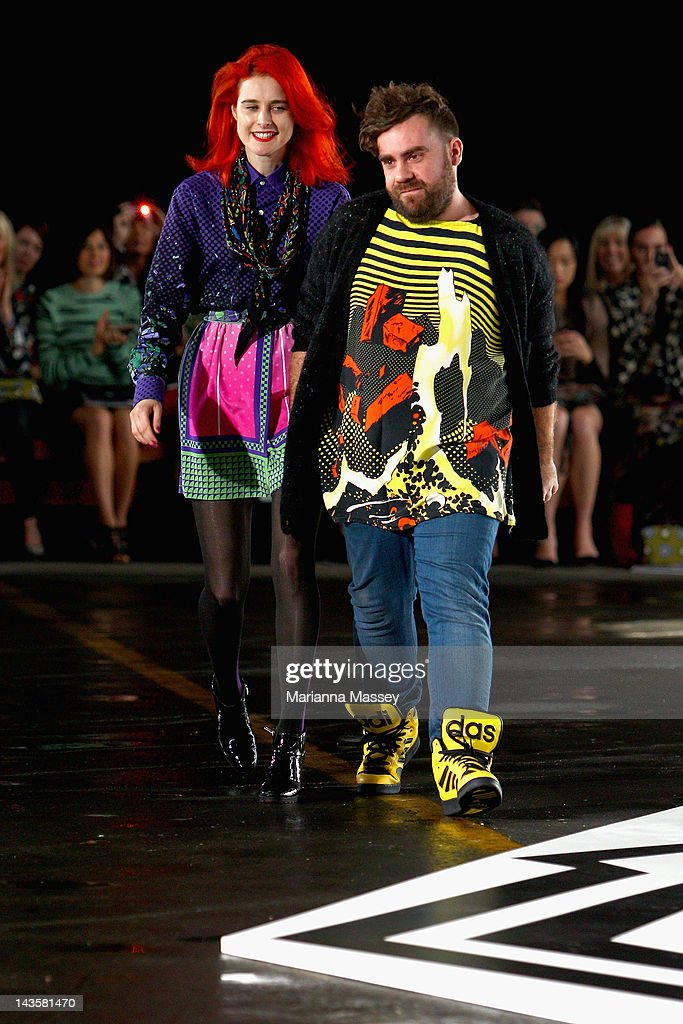 Designers Luke Sales and Anna Plunkett of Romance Was Born acknowledge the crowd at the end of their Romance Was Born show on day one of Mercedes-Benz Fashion Week Australia Spring/Summer 2012/13 at Pier 2 on April 30, 2012 in Sydney, Australia.