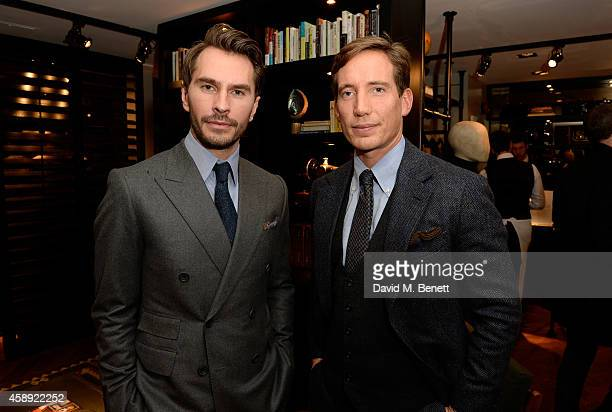 Designers Luke Sweeney and Thom Whiddett attend the opening of their new Thom Sweeney RTW & MTM Store on November 13, 2014 in London, England.