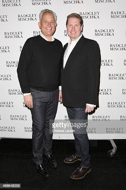 Designers Mark Badgley and James Mischka pose backstage at the Badgley Mischka fashion show during MercedesBenz Fashion Week Fall 2014 at The Theatre...