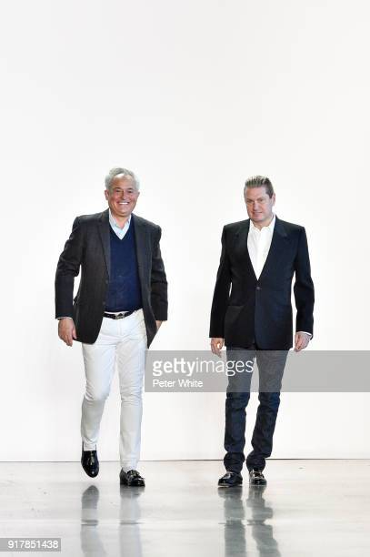 Designers Mark Badgley and James Mischka walk the runway after the Badgley Mischka fashion show during New York Fashion Week at Gallery I at Spring...