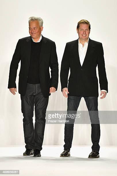 Designers Mark Badgley and James Mischka walk the runway at the Badgley Mischka fashion show during MercedesBenz Fashion Week Fall 2014 at The...