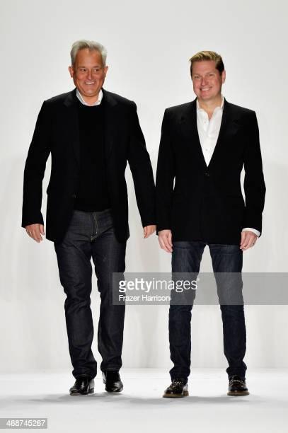 Designers Mark Badgley and James Mischka walk the runway at the Badgley Mischka fashion show during MercedesBenz Fashion Week Fall 2014 at Lincoln...