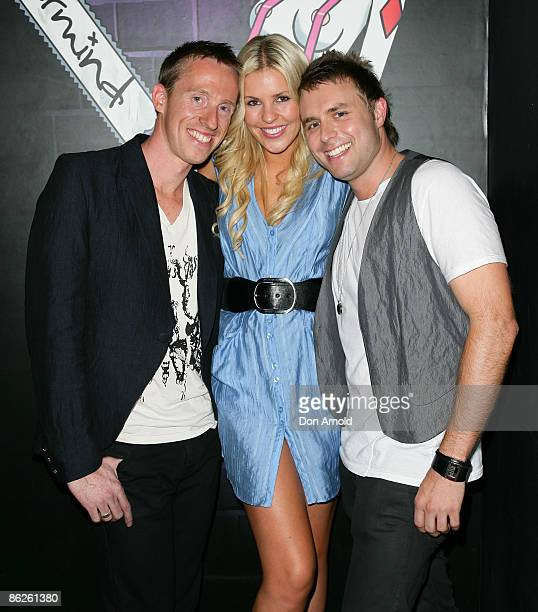 Designers Mark Rogers and Andy Mac pose with Jaime Wright at the `UnNakeD` after show party at the Overseas Passenger Terminal, Circular Quay on day...