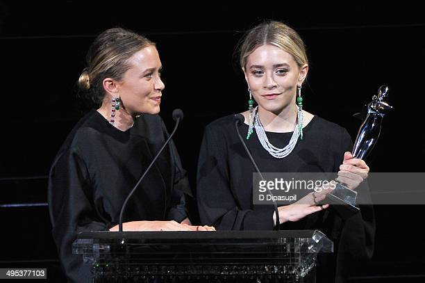 Designers MaryKate Olsen and Ashley Olsen speak onstage at the 2014 CFDA fashion awards at Alice Tully Hall Lincoln Center on June 2 2014 in New York...
