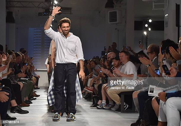 Designers Massimo Giorgetti acknowledges the applause of the audience after the MSGM show as part of Milan Fashion Week Menswear Spring/Summer 2015...