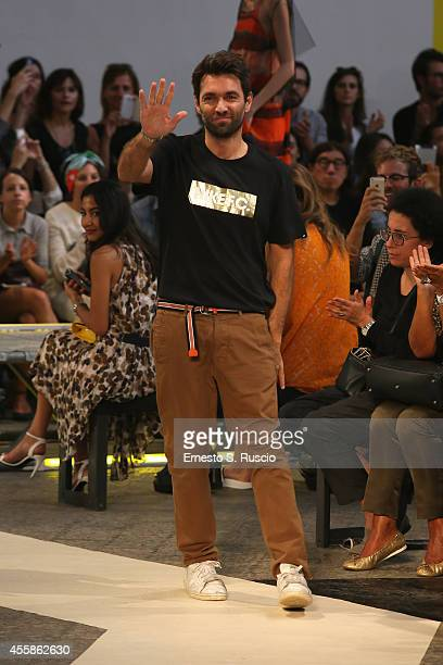 Designers Massimo Giorgetti acknowledges the applause of the audience after the the MSGM show as a part of the Milan Fashion Week Womenswear...